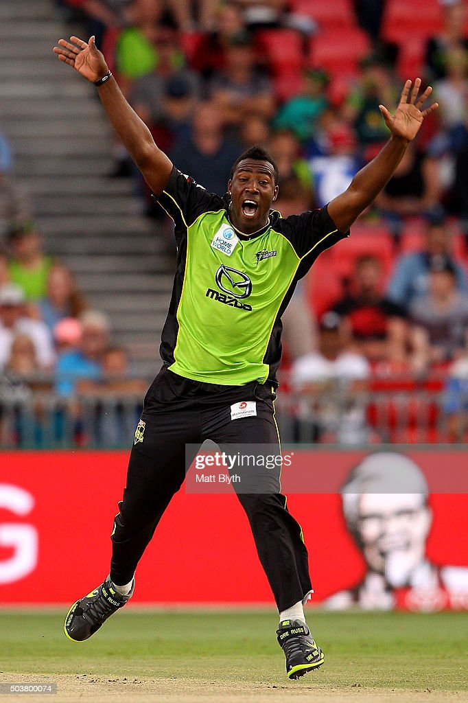 Andre Russell of the Thunder celebrates the wicket of Michael Klinger of the Scorchers during the Big Bash League match between the Sydney Thunder and the Perth Scorchers at Spotless Stadium on January 7, 2016 in Sydney, Australia.