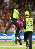 Andre Russell of the Thunder celebrates with team mates after taking the wicket of Brad Haddin of the Sixers during the Big Bash League match between...