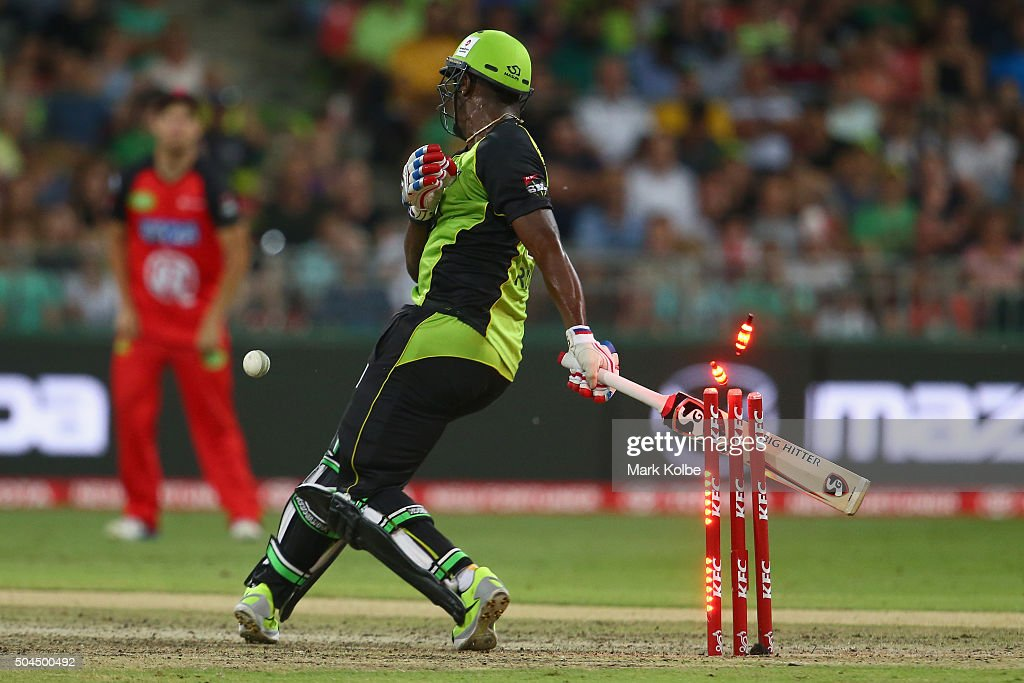Andre Russell of the Thunder falls on his stumps to be out hit wicket after being struck by a short ball from Nathan Rimmington of the Renegades during the Big Bash League match between the Sydney Thunder and the Melbourne Renegades at Spotless Stadium on January 11, 2016 in Sydney, Australia.
