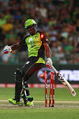 Andre Russell of the Thunder falls on his stumps to be out hit wicket after being struck by a short ball from Nathan Rimmington of the Renegades...