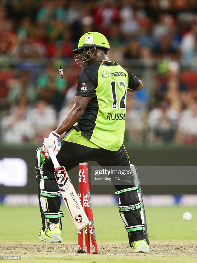 Andre Russell of the Thunder falls over his own wicket to be dismissed during the Big Bash League match between the Sydney Thunder and the Melbourne Renegades at Spotless Stadium on January 11, 2016 in Sydney, Australia.