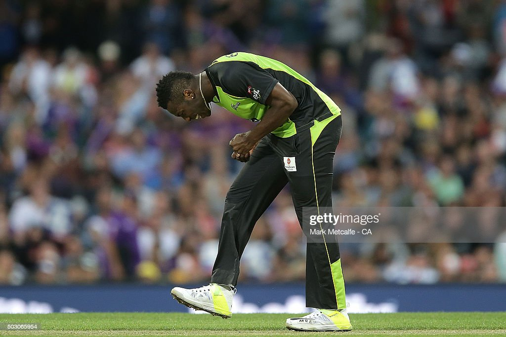 Andre Russell of the Thunder reacts to being hit for four during the Big Bash League match between the Hobart Hurricanes and the Sydney Thunder at Blundstone Arena on January 1, 2016 in Hobart, Australia.