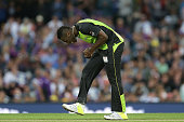 Andre Russell of the Thunder reacts to being hit for four during the Big Bash League match between the Hobart Hurricanes and the Sydney Thunder at...