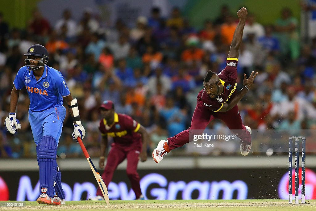<a gi-track='captionPersonalityLinkClicked' href=/galleries/search?phrase=Andre+Russell&family=editorial&specificpeople=5348594 ng-click='$event.stopPropagation()'>Andre Russell</a> of the West Indies bowls during the 2015 ICC Cricket World Cup match between India and the West Indies at WACA on March 6, 2015 in Perth, Australia.
