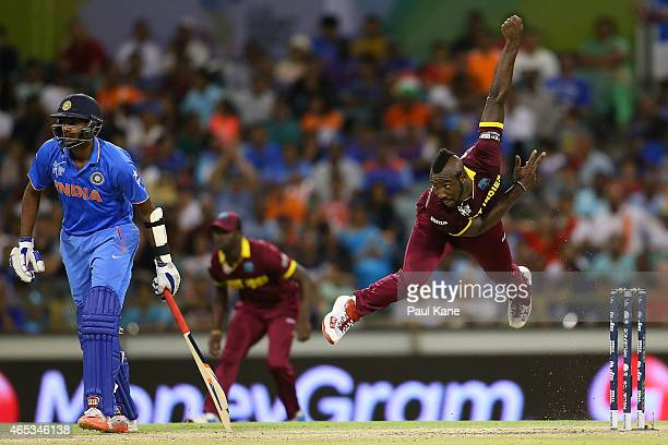 Andre Russell of the West Indies bowls during the 2015 ICC Cricket World Cup match between India and the West Indies at WACA on March 6 2015 in Perth...