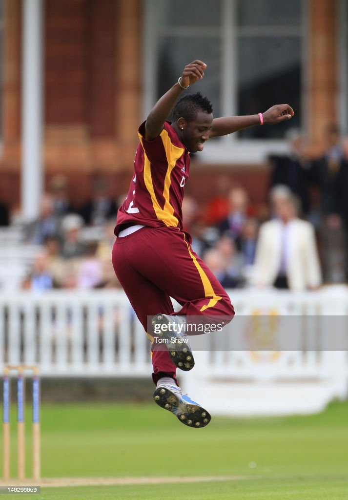 <a gi-track='captionPersonalityLinkClicked' href=/galleries/search?phrase=Andre+Russell&family=editorial&specificpeople=5348594 ng-click='$event.stopPropagation()'>Andre Russell</a> of the West Indies celebrates taking the wicket of Sam Robson of Middlesex during the tour match between Middlesex and West Indies at Lord's Cricket Ground on June 13, 2012 in London, England.