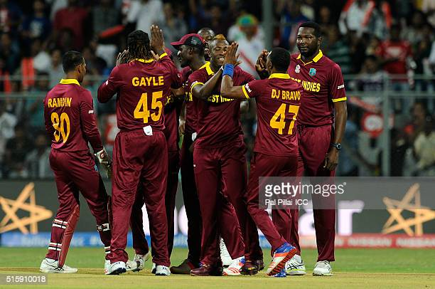 Andre Russell of the West Indies celebrates the wicket of Jason Roy of England during the ICC World Twenty20 India 2016 match between West Indies and...