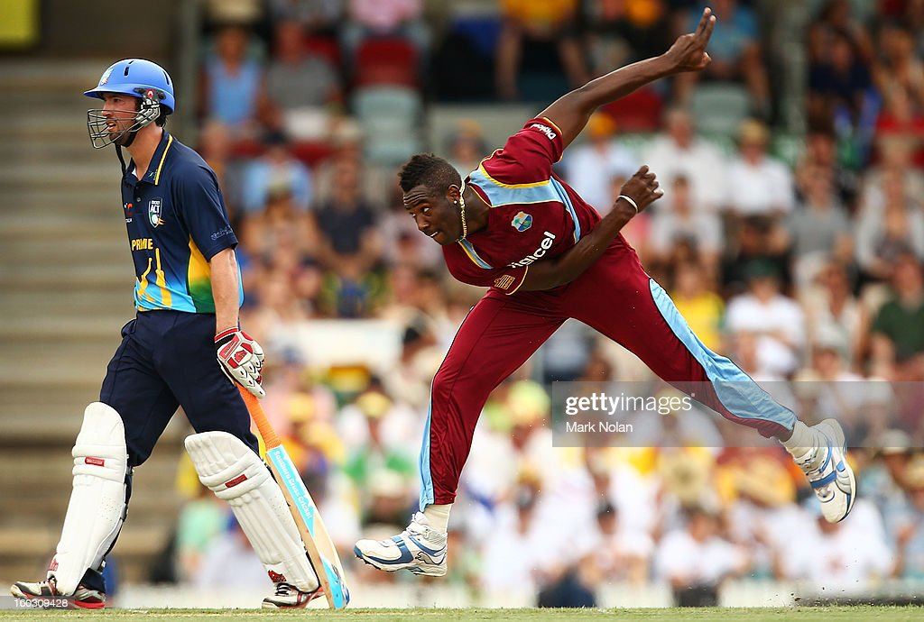 Andre Russell of the West Inides bowls during the International Tour Match between the Prime Minister's XI and West Indies at Manuka Oval on January 29, 2013 in Canberra, Australia.