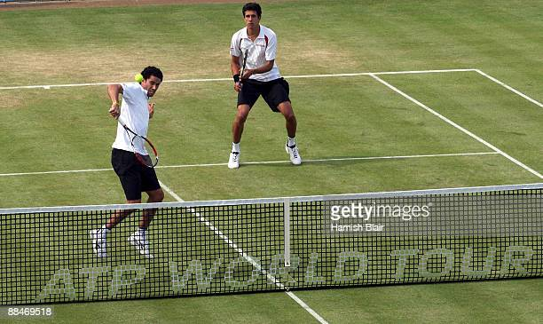 Andre Sa of Brazil plays a backhand playing with Marcelo Melo of Brazil during the men's doubles semi final match against Jeff Coetzee of South...