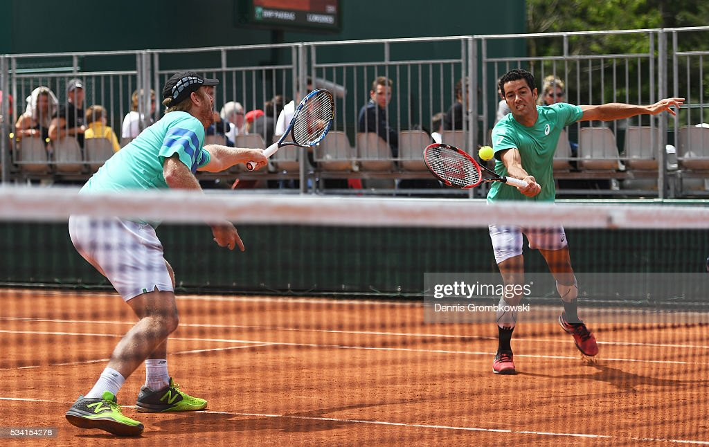 Andre Sa of Brazil plays a forehand alongside <a gi-track='captionPersonalityLinkClicked' href=/galleries/search?phrase=Chris+Guccione+-+Joueur+de+tennis&family=editorial&specificpeople=217596 ng-click='$event.stopPropagation()'>Chris Guccione</a> of Australia during the Men's Doubles first round match against Juan Sebastian Cabal and Robert Farah of Columbia on day four of the 2016 French Open at Roland Garros on May 25, 2016 in Paris, France.