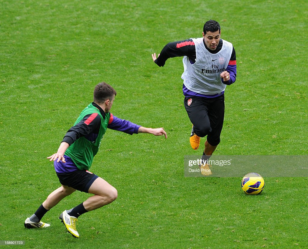 Andre Santos and Carl Jenkinson of Arsenal during a training session at Emirates Stadium on January 03, 2013 in London, England.