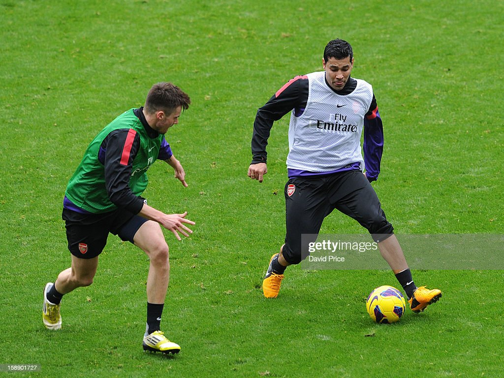 Andre Santos and Carl Jenkinson of Arsenal in action during a training session at Emirates Stadium on January 03, 2013 in London, England.