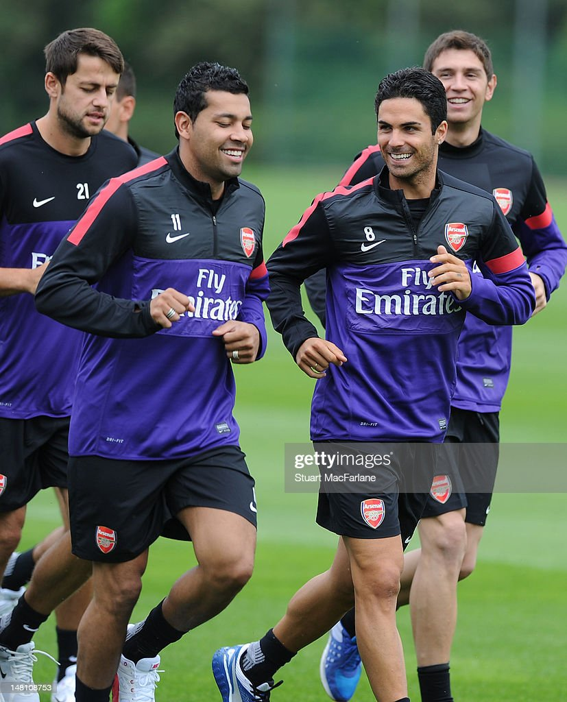 Andre Santos (centre L), <a gi-track='captionPersonalityLinkClicked' href=/galleries/search?phrase=Mikel+Arteta&family=editorial&specificpeople=235322 ng-click='$event.stopPropagation()'>Mikel Arteta</a> (centre R) and Arsenal players jog during a training session at London Colney on July 10, 2012 in St Albans, England.