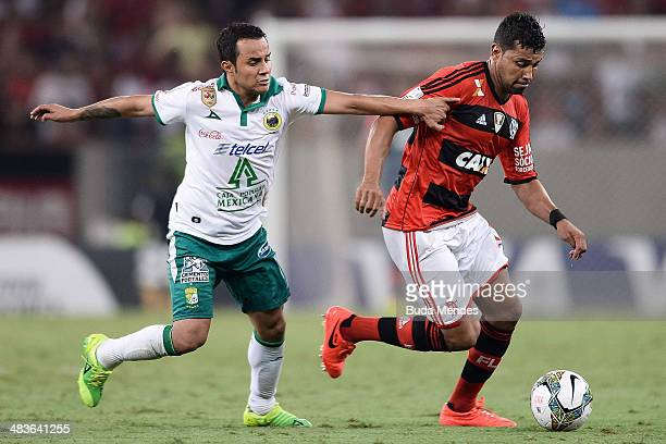Andre Santos of Flamengo battles for the ball against Montes of Leon during a match between Flamengo and Leon as part of Copa Bridgestone...