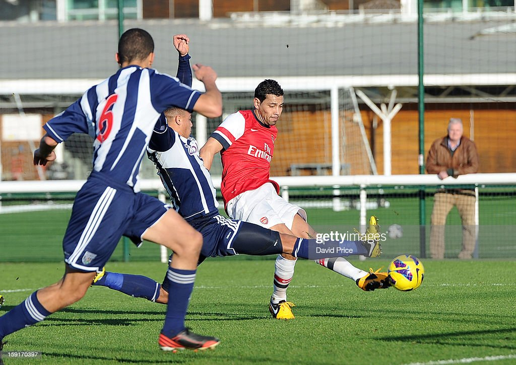 Andre Santos scores a goal for Arsenal under pressure from Wesley Atkinson of WBA during the Barclays Premier U21 match between Arsenal U21 and West Bromwich Albion U21 at London Colney on January 9, 2013 in St Albans, United Kingdom.