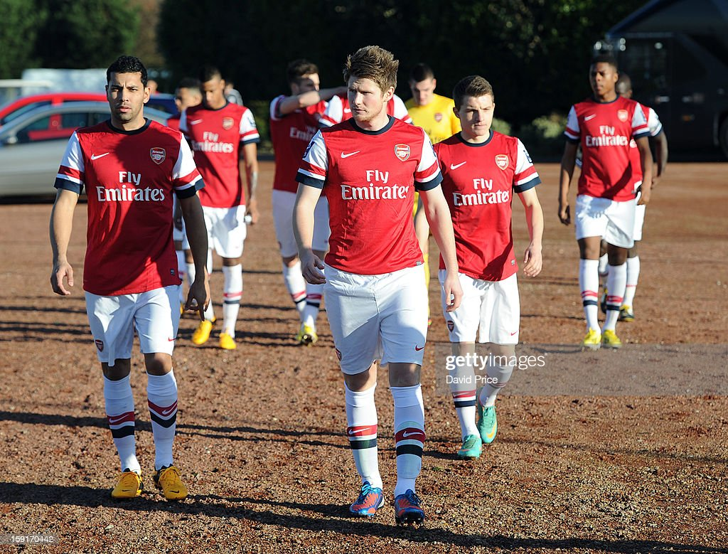 Andre Santos Sead Hajrovic and Thomas Eisfeld of Arsenal walk out to the pitch before the Barclays Premier U21 match between Arsenal U21 and West...
