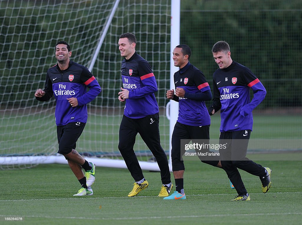 Andre Santos Thomas Vermaelen Theo Walcott and Aaron Ramsey of Arsenal during a training session at London Colney on November 2 2012 in St Albans...