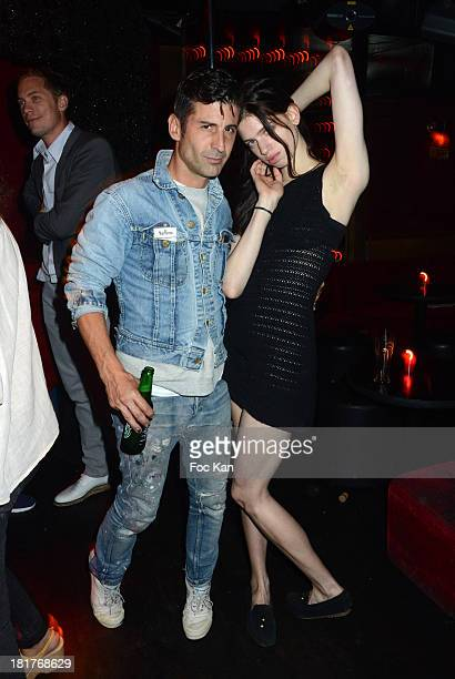 Andre Saraiva and model Lily McMenamy attend the 'Haute Performance' By Andre Saraiva After Party At Le Baron on September 24 2013 in Paris France