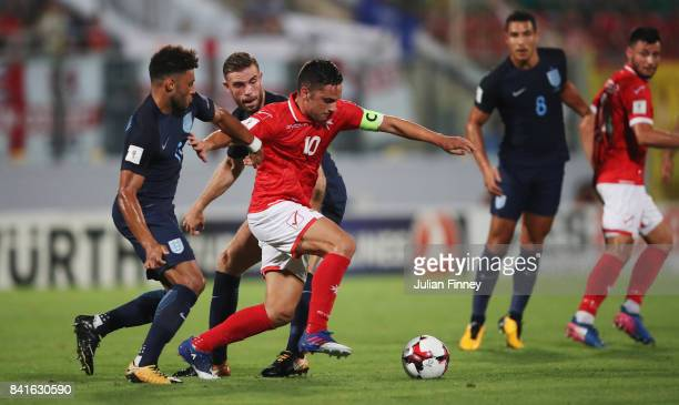 Andre Schembri of Malta battles with Alex OxladeChamberlain and Jordan Henderson of England during the FIFA 2018 World Cup Qualifier between Malta...