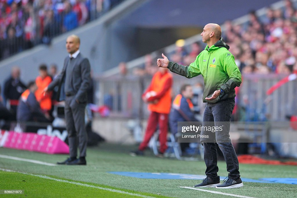 Andre Schubert, Head Coach of Borussia Moenchengladbach gives the thumbs up during the Bundesliga match between Bayern Muenchen and Borussia Moenchengladbach at Allianz Arena on April 30, 2016 in Munich, Germany.