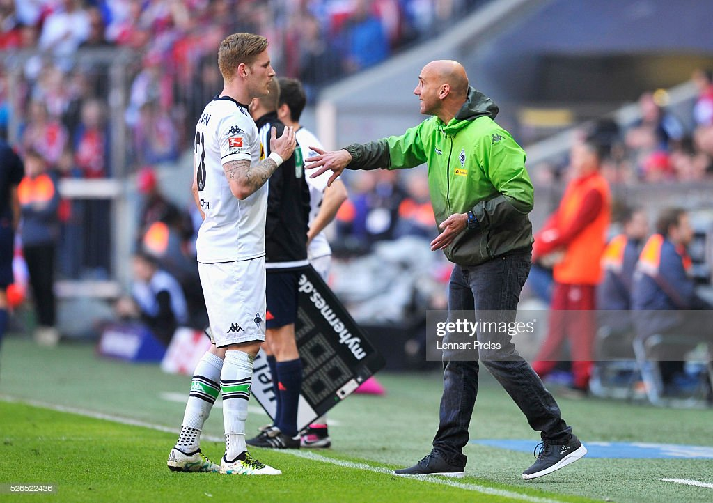 Andre Schubert, Head Coach of Borussia Moenchengladbach talks to Andre Hahn during the Bundesliga match between Bayern Muenchen and Borussia Moenchengladbach at Allianz Arena on April 30, 2016 in Munich, Germany.
