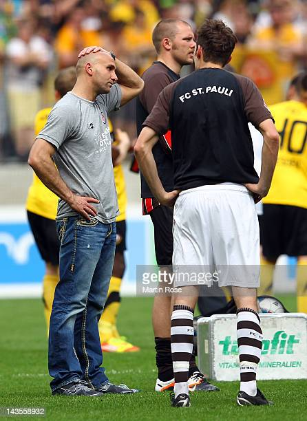 Andre Schubert head coach of StPauli looks dejected after the Second Bundesliga match between Dynamo Dresden and StPauli at GluecksgasStadion on...