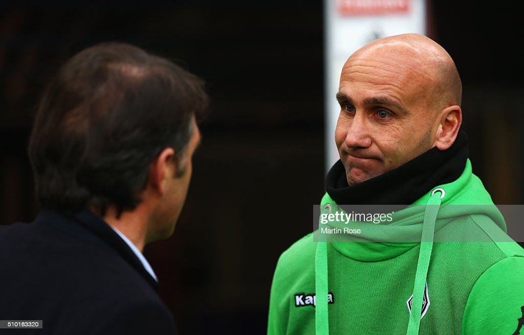 Andre Schubert manager of Borussia Moenchengladbach (R) and <a gi-track='captionPersonalityLinkClicked' href=/galleries/search?phrase=Bruno+Labbadia&family=editorial&specificpeople=653790 ng-click='$event.stopPropagation()'>Bruno Labbadia</a> head coach of SV Hamburg in discussion prior to the Bundesliga match between Hamburger SV and Borussia Moenchengladbach at Volksparkstadion on February 14, 2016 in Hamburg, Germany.