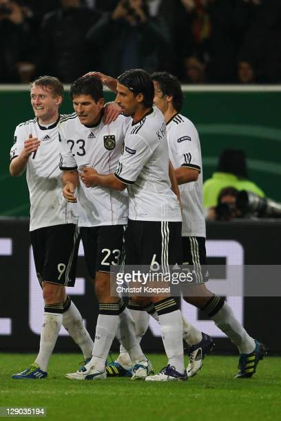 Andre Schuerrle celebrates the second goal with Mario Gomez Sami Khedria and Mats Hummels of Germany during the UEFA EURO 2012 Group A qualifying...