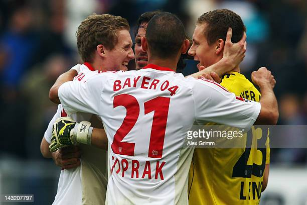 Andre Schuerrle Manuel Friedrich Oemer Toprak and goalkeeper Bernd Leno of Leverkusen celebrate after the Bundesliga match between 1899 Hoffenheim...