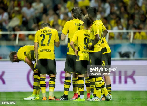 Andre Schuerrle of Borussia Dortmund celebrates after his winning goal to 32 with his teammates during the preseason friendly match between Urawa Red...