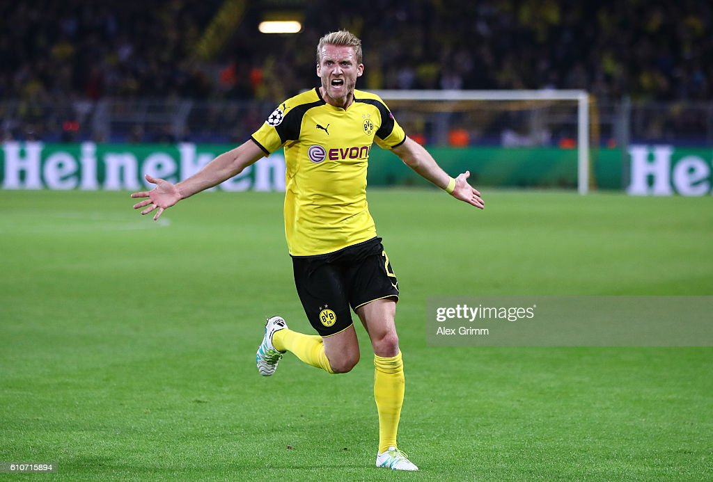 Andre Schuerrle of Borussia Dortmund celebrates as he scores their second goal during the UEFA Champions League Group F match between Borussia Dortmund and Real Madrid CF at Signal Iduna Park on September 27, 2016 in Dortmund, North Rhine-Westphalia.