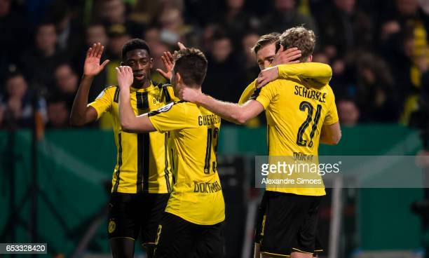 Andre Schuerrle of Borussia Dortmund celebrates scoring the goal to the 02 together with his team mates during the DFB Cup Quarter Final match...