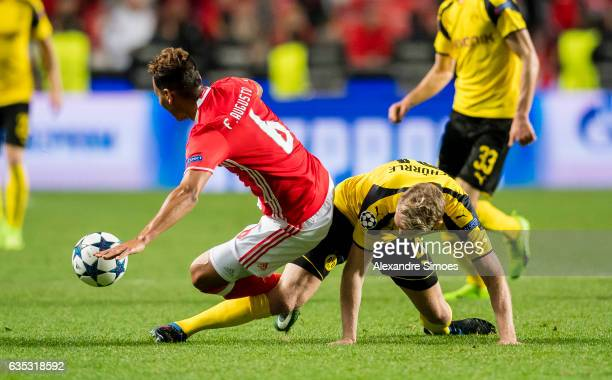 Andre Schuerrle of Borussia Dortmund challenges Filipe Augusto of SL Benfica during the UEFA Champions League Round of 16 First Leg match between SL...