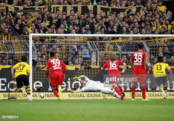 Andre Schuerrle of Borussia Dortmund scores a penalty during the Bundesliga soccer match between Borussia Dortmund and Bayer 04 Leverkusen at the...