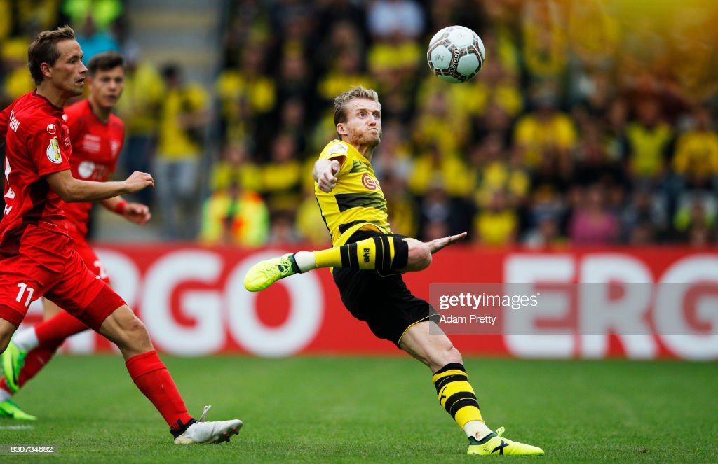 Andre Schuerrle of Borussia Dortmund takes a shot during the DFB Cup match between 1. FC Rielasingen-Arlen and Borussia Dortmund at Schwarzwald-Stadion on August 12, 2017 in Freiburg im Breisgau, Germany.