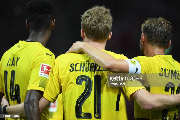 Andre Schuerrle of Burussia Dortmund celebrates scoring his side's third goal during the preseason friendly match between Urawa Red Diamonds and...