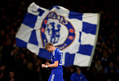 Andre Schuerrle of Chelsea celebrates after scoring his team's second goal during the UEFA Champions League group G match between Chelsea and...