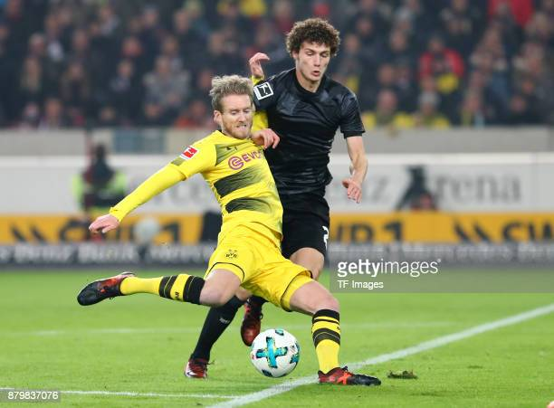 Andre Schuerrle of Dortmund and Benjamin Pavard of Stuttgart battle for the ball during the Bundesliga match between VfB Stuttgart and Borussia...