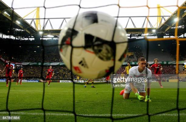 Andre Schuerrle of Dortmund scores his teams fifth goal against goalkeeper Bernd Leno of Bayer Leverkusen during the Bundesliga match between...