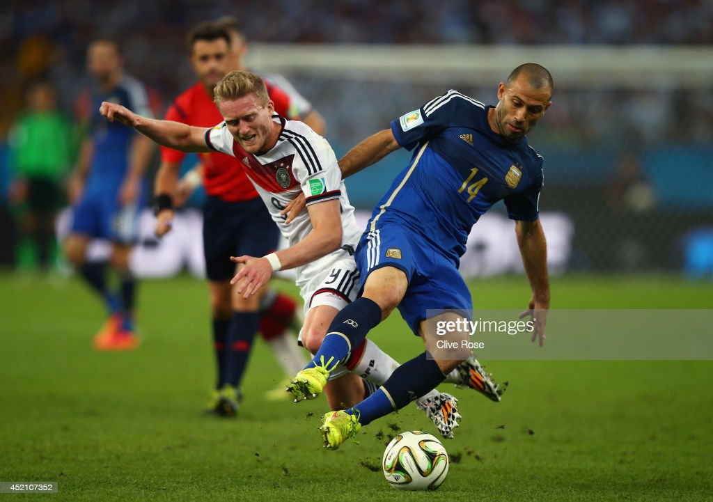 <a gi-track='captionPersonalityLinkClicked' href=/galleries/search?phrase=Andre+Schuerrle&family=editorial&specificpeople=5513825 ng-click='$event.stopPropagation()'>Andre Schuerrle</a> of Germany and <a gi-track='captionPersonalityLinkClicked' href=/galleries/search?phrase=Javier+Mascherano&family=editorial&specificpeople=490876 ng-click='$event.stopPropagation()'>Javier Mascherano</a> of Argentina compete for the ball during the 2014 FIFA World Cup Brazil Final match between Germany and Argentina at Maracana on July 13, 2014 in Rio de Janeiro, Brazil.