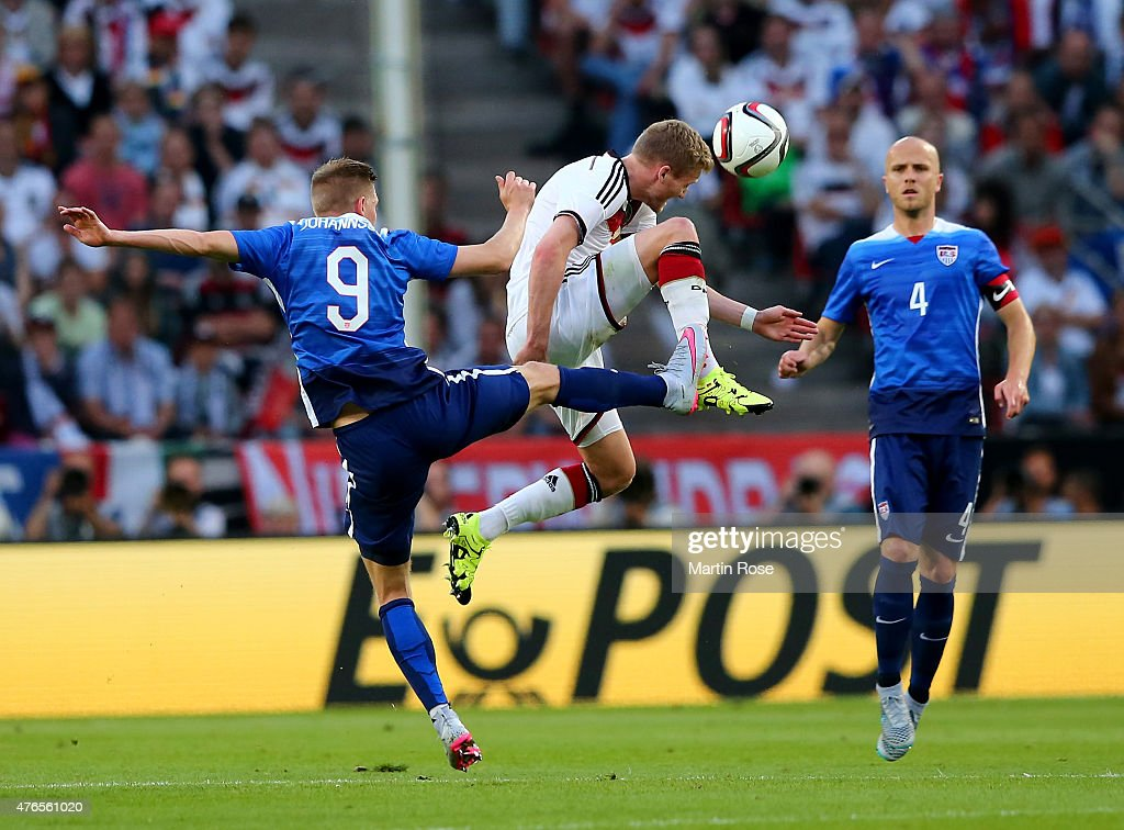 Andre Schuerrle of Germany battles for the ball with Aron Johannsson of USA during the International Friendly match between Germany and USA at...