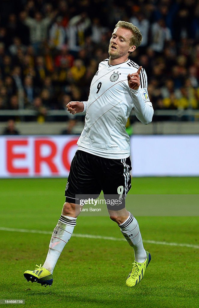 <a gi-track='captionPersonalityLinkClicked' href=/galleries/search?phrase=Andre+Schuerrle&family=editorial&specificpeople=5513825 ng-click='$event.stopPropagation()'>Andre Schuerrle</a> of Germany celebrates after scoring his teams fourth goal during the FIFA 2014 World Cup Qualifying Group C match between Sweden and Germany at Friends Arena Solna on October 15, 2013 in Stockholm, Sweden.