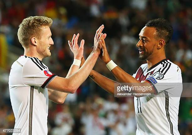 Andre Schuerrle of Germany celebrates scoring his second goal and his team's fifth with Karim Bellarabi during the UEFA EURO 2016 Qualifier Group D...