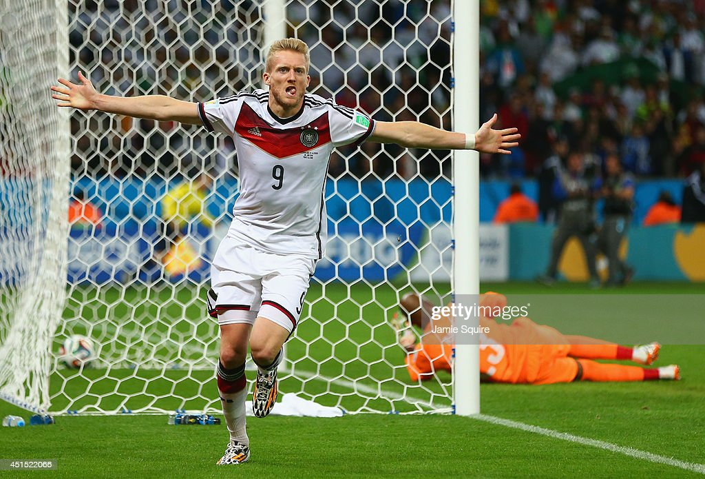 <a gi-track='captionPersonalityLinkClicked' href=/galleries/search?phrase=Andre+Schuerrle&family=editorial&specificpeople=5513825 ng-click='$event.stopPropagation()'>Andre Schuerrle</a> of Germany celebrates scoring his team's first goal past goalkeeper Rais M'Bolhi of Algeria during the 2014 FIFA World Cup Brazil Round of 16 match between Germany and Algeria at Estadio Beira-Rio on June 30, 2014 in Porto Alegre, Brazil.