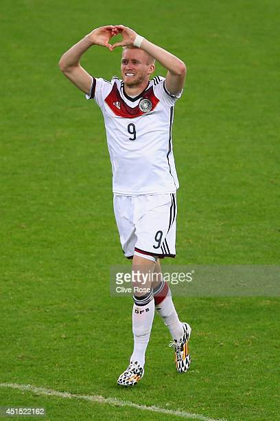 Andre Schuerrle of Germany celebrates scoring his team's first goal during the 2014 FIFA World Cup Brazil Round of 16 match between Germany and...