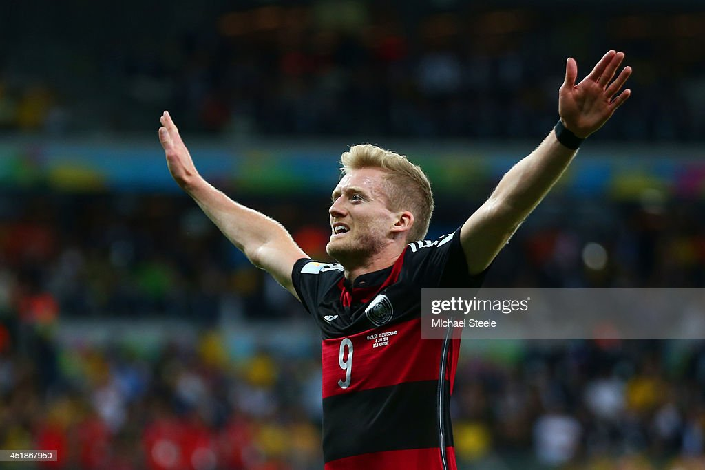 <a gi-track='captionPersonalityLinkClicked' href=/galleries/search?phrase=Andre+Schuerrle&family=editorial&specificpeople=5513825 ng-click='$event.stopPropagation()'>Andre Schuerrle</a> of Germany celebrates scoring his team's seventh goal and his second of the game during the 2014 FIFA World Cup Brazil Semi Final match between Brazil and Germany at Estadio Mineirao on July 8, 2014 in Belo Horizonte, Brazil.