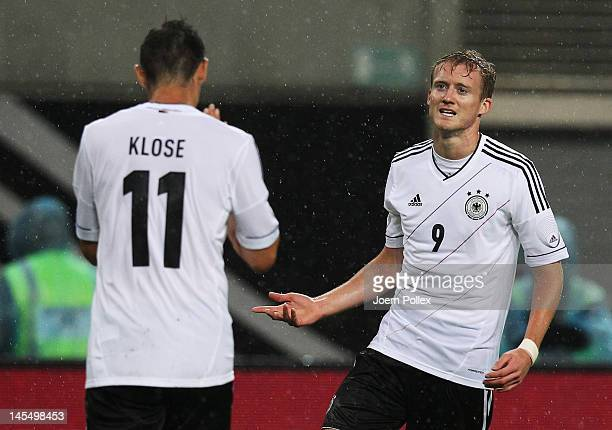 Andre Schuerrle of Germany celebrates with his team mate Miroslav Klose after scoring his team's second goal during the international friendly match...