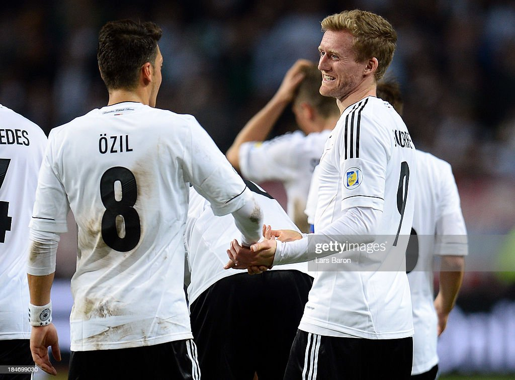 <a gi-track='captionPersonalityLinkClicked' href=/galleries/search?phrase=Andre+Schuerrle&family=editorial&specificpeople=5513825 ng-click='$event.stopPropagation()'>Andre Schuerrle</a> of Germany celebrates with Mesut Ozil after scoring his teams fives goal during the FIFA 2014 World Cup Qualifying Group C match between Sweden and Germany at Friends Arena Solna on October 15, 2013 in Stockholm, Sweden.