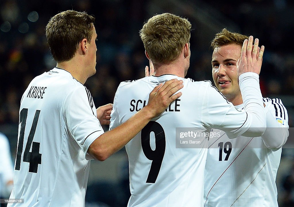 <a gi-track='captionPersonalityLinkClicked' href=/galleries/search?phrase=Andre+Schuerrle&family=editorial&specificpeople=5513825 ng-click='$event.stopPropagation()'>Andre Schuerrle</a> of Germany celebrates with team mate <a gi-track='captionPersonalityLinkClicked' href=/galleries/search?phrase=Mario+Goetze&family=editorial&specificpeople=4251202 ng-click='$event.stopPropagation()'>Mario Goetze</a> after scoring his teams fourth goal during the FIFA 2014 World Cup Qualifying Group C match between Sweden and Germany at Friends Arena Solna on October 15, 2013 in Stockholm, Sweden.