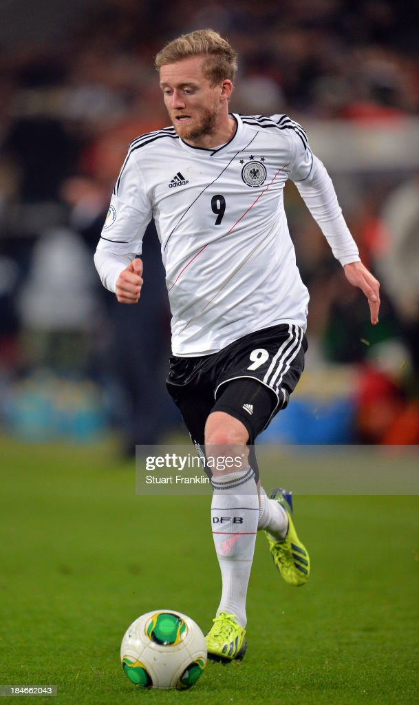 <a gi-track='captionPersonalityLinkClicked' href=/galleries/search?phrase=Andre+Schuerrle&family=editorial&specificpeople=5513825 ng-click='$event.stopPropagation()'>Andre Schuerrle</a> of Germany in action during the FIFA world Cup 2014 qualification match between Germany and Republic of Ireland at the Rheinenergy stadium on October 11, 2013 in Cologne, Germany.